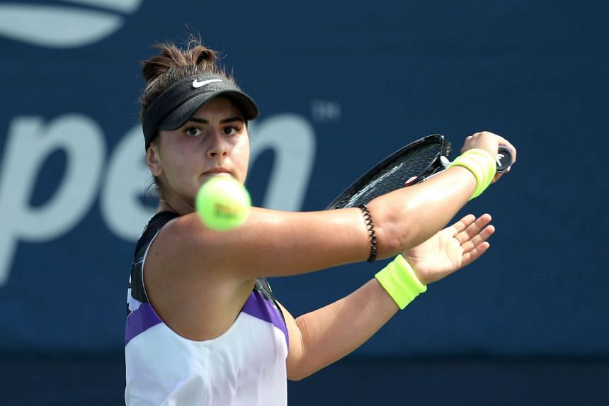 Andreescu returns a shot against Katie Volynets of the United States.