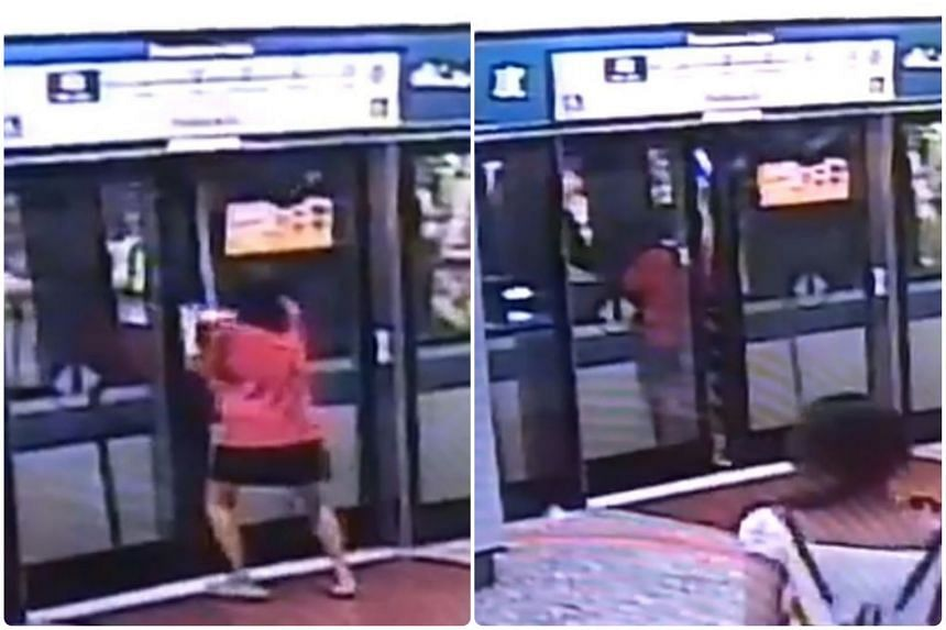 The woman was seen prising open the platform doors, before attempting to open the closed train doors.