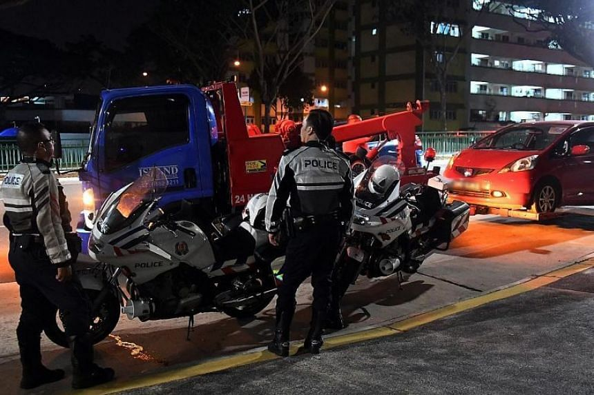 A car, believed to have been driven by the man who fled after leaving an unconscious baby in critical condition at Singapore General Hospital, being towed away.