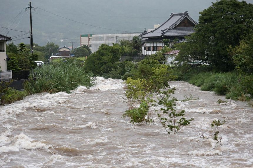 Rising water caused by heavy rain is seen at Muromi river in Fukuoka on Aug 28, 2019.