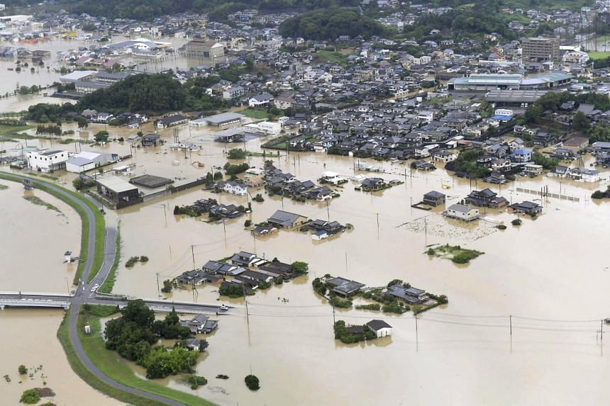 An aerial view shows submerged houses and facilities at a flooded area in Takeo, Saga prefecture, southern Japan, on Aug 28, 2019.