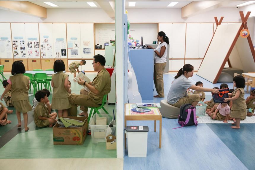 Teachers interacting with students at a kindergarten in Singapore.
