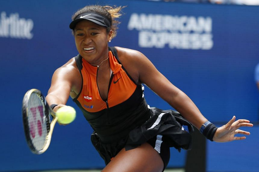 Naomi Osaka said the nerves that come with being a first-time defending champion played a part in her slow start.