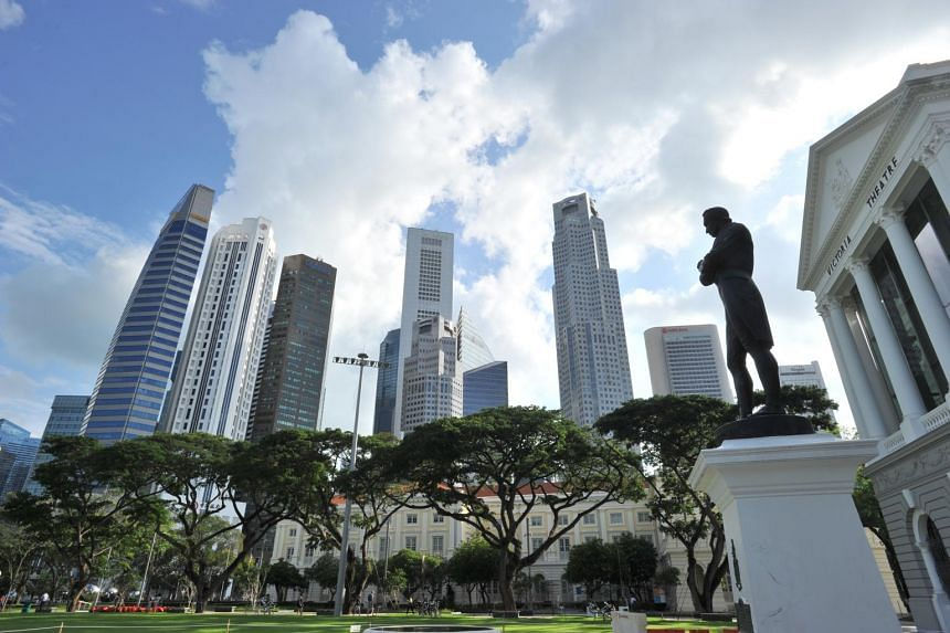 The statue of Sir Stamford Raffles outside the Victoria Theatre in Singapore's civic district.