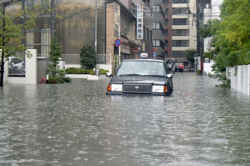 Footage on local television showed rivers swollen by rainwater and parked cars surrounded by muddy brown water rising nearly up to the vehicles' roofs.