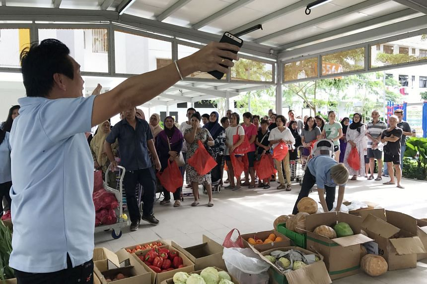 People waiting for the distribution of produce by The Food Bank Singapore. A Singapore Food Agency spokesman says Good Samaritan laws are being explored here. This could give businesses more protection when they donate food, and could raise the amoun