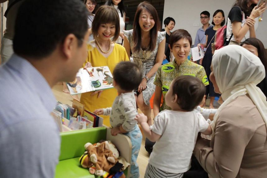 Senior Minister of State for Health Amy Khor (left) and Manpower Minister Josephine Teo (right) with pre-schoolers from My First Skool at 2 Punggol Drive.
