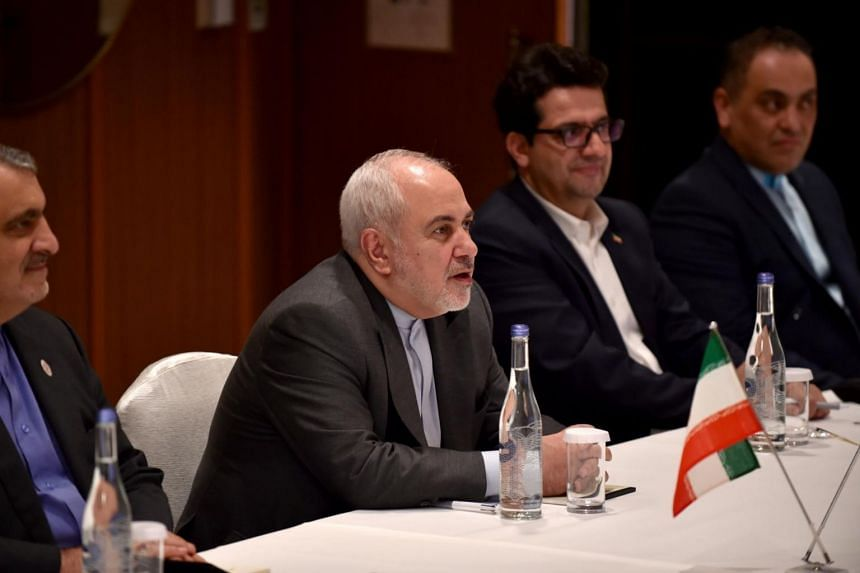 Immediately on arrival, Iranian foreign minister Mohammad Javad Zarif (centre) conveyed a blunt message to America, saying that he will not be holding talks with the US delegation during his sudden trip.