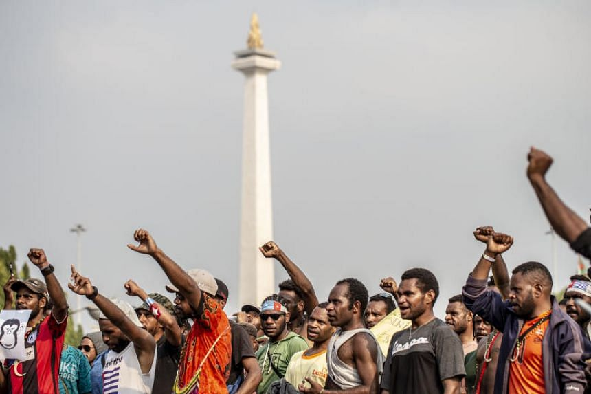 In a photo taken on Aug 22, students from Papua take part in a protest in front of Merdeka Palace to call for a referendum on independence.