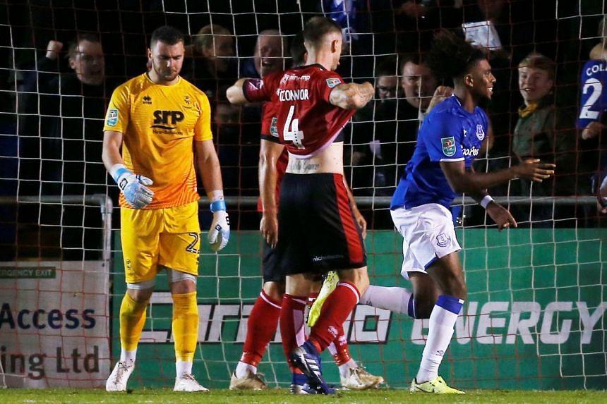 Everton's Alex Iwobi celebrates scoring their third goal.