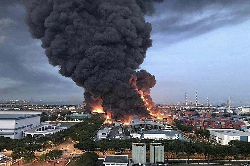 The fire at Eco Special Waste Management's Tuas plant on Feb 23, 2017. It broke out when a worker was discharging recovered liquid hexane from a product tank into a plastic intermediate bulk container.