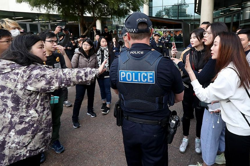 Police separating pro-Beijing students and pro-Hong Kong protesters outside the University of South Australia in Adelaide earlier this month.