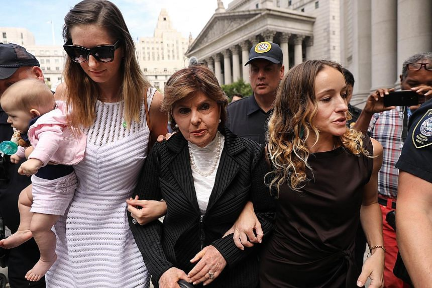 Attorney Gloria Allred (centre) leaving a New York courthouse on Tuesday with two women who have publicly accused Jeffrey Epstein of sexually assaulting them.