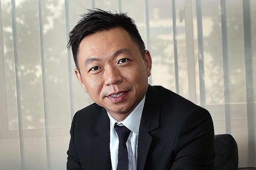 The beverage giant removed Mr Alain Ong from his posts last September after internal investigations.