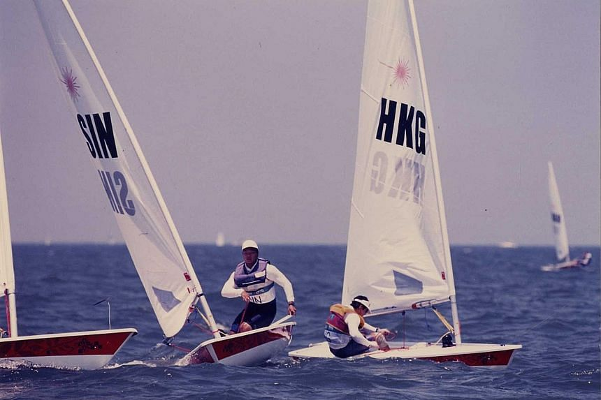 Top: Former national sailor Benedict Tan will be Singapore's chef de mission at next year's Tokyo Olympics. ST PHOTO: LIM YAO HUI Tan, pictured in action at the Atlanta Olympics in 1996, when he finished 36th out of 56. Now 51, he is head of SingHeal