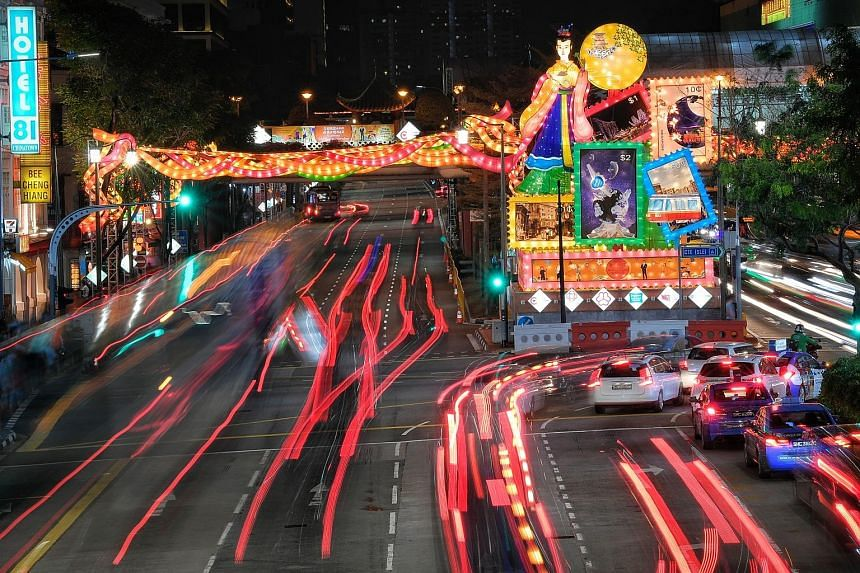 The 11m-tall installation of Chang'e at the junction of Eu Tong Sen Street and Upper Cross Street for the Chinatown Mid-Autumn Festival. Other installations include (below) Sir Stamford Raffles and an attap hut on New Bridge Road.