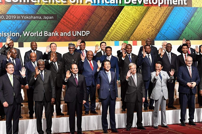 """Japan's Prime Minister Shinzo Abe (centre), flanked by African Union chairman and Egyptian President Abdel Fattah al-Sisi and UN chief Antonio Guterres in a """"family photo"""" with other participants at the Tokyo International Conference on African Devel"""