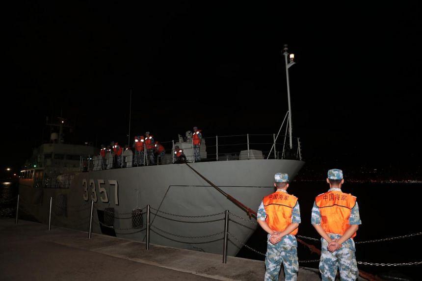 A ship from China's People's Liberation Army (PLA) navy arrives at a naval base on Stonecutters Island in Hong Kong on Aug 29, 2019.