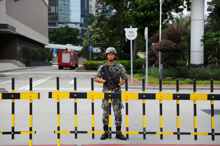 A Chinese People's Liberation Army (PLA) soldier guards the entrance to the PLA Hong Kong Garrison headquarters in the Central Business District in Hong Kong on Aug 29, 2019.