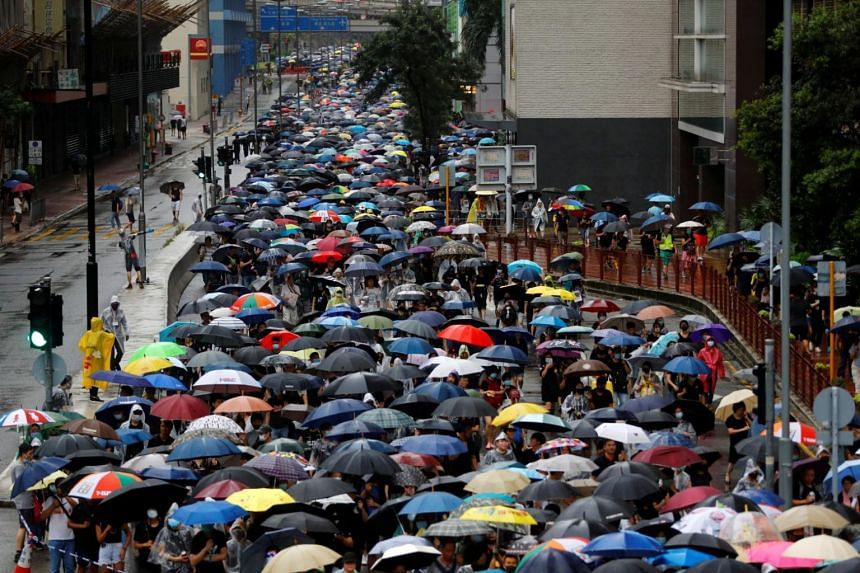In a photo taken on Aug 25, 2019, demonstrators march in the rain during a protest in the Kwai Fong district of Hong Kong.