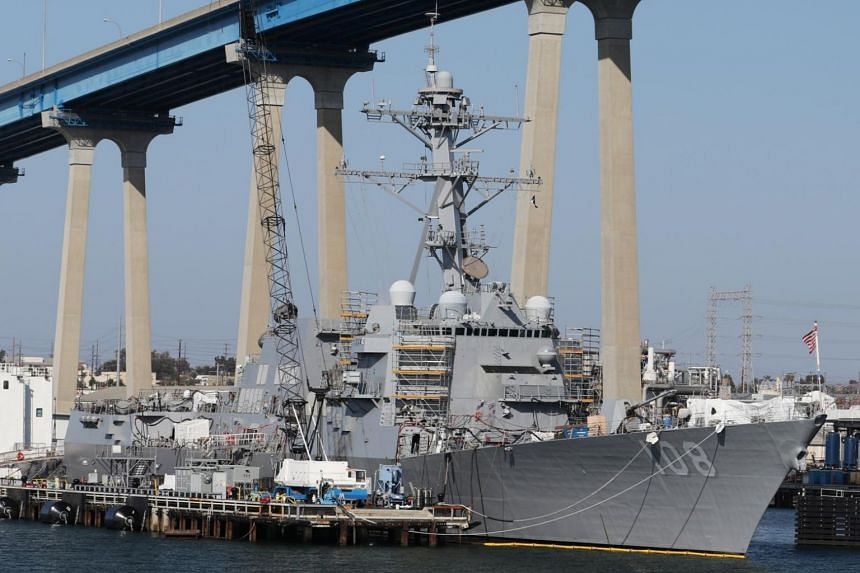 In a photo from April 12, 2015, the US Navy vessel Wayne E. Meyer, an Arleigh Burke-class guided missile destroyer, sits docked in San Diego, California.
