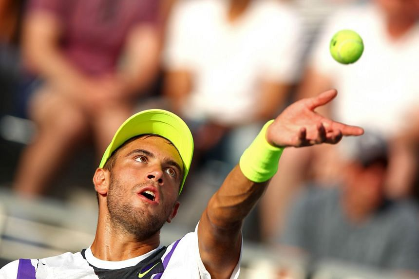 Coric serves during his first-round match against Evgeny Donskoy of Russia during day one of the US Open.