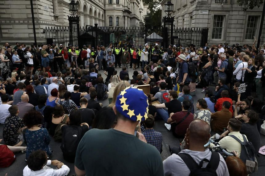 Anti-Brexit supporters gather outside the Prime Minister's residence 10 Downing Street in London on Aug 28, 2019.