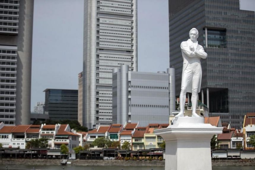 Statue of Sir Stamford Raffles along the Singapore River.