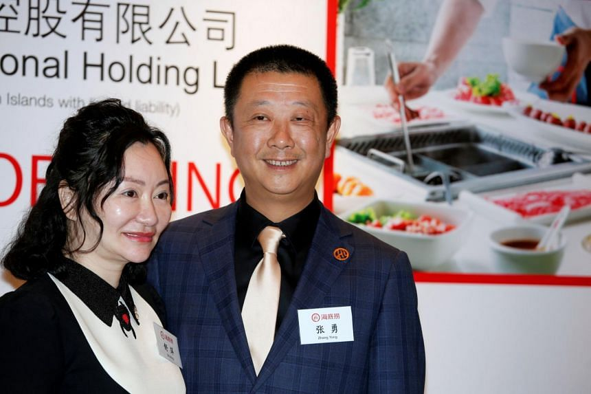 In this photo taken on Sept 10, 2018, Zhang Yong, co-founder, chairman and CEO of Sichuan Haidilao Catering, is with his wife Shu Ping, co-founder and non-executive director, before an investors' luncheon ahead of the company's IPO in Hong Kong.