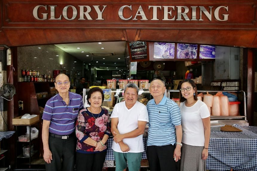 Second generation owner Chin Der Ann (second from right), with his daughter Wendy Chin (right), sister Chin Choon Siang (second from left), brother-in-law Tan Hee Liang (far left), and long-time patron James Ee (centre), at Glory Catering on Tuesday.