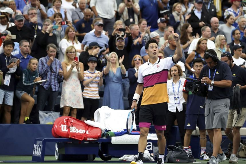 Nishikori reacts after defeating Bradley Klahn of the United States.