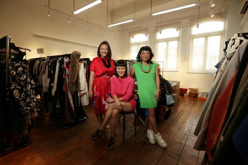 (From left) Founders Petrina Kow, Janice Koh and Pam Oei wearing Pasar Glamour donations in a holding room for the donations.