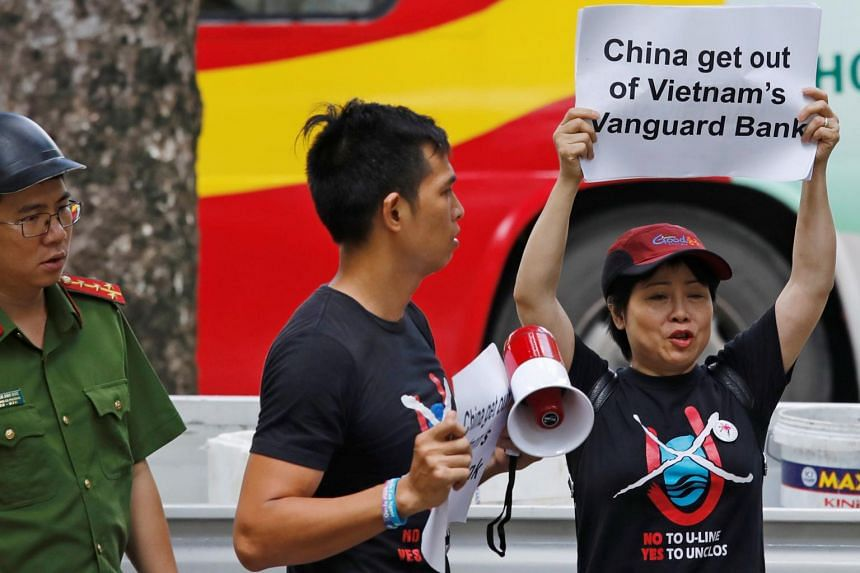 Anti-China protesters hold placards during a demonstration in front of the Chinese embassy in Hanoi, Vietnam on Aug 6, 2019.