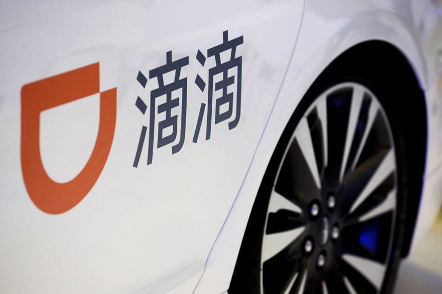 The Didi Chuxing logo is seen on a car at the IEEV New Energy Vehicles Exhibition in Beijing, China.