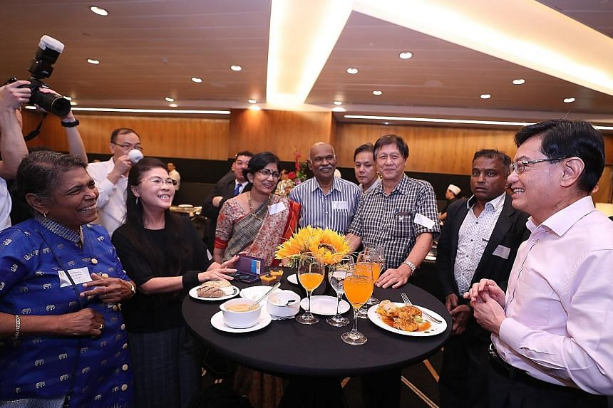 Deputy Prime Minister Heng Swee Keat mingling with participants before a closed-door dialogue organised by government feedback unit Reach yesterday. ST PHOTO: TIMOTHY DAVID