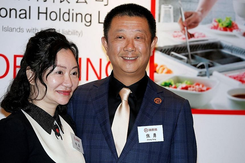 Hotpot chain Haidilao founder Zhang Yong, seen here with his wife Shu Ping, has a net worth of US$13.8 billion (S$19.15 billion). PHOTO: REUTERS