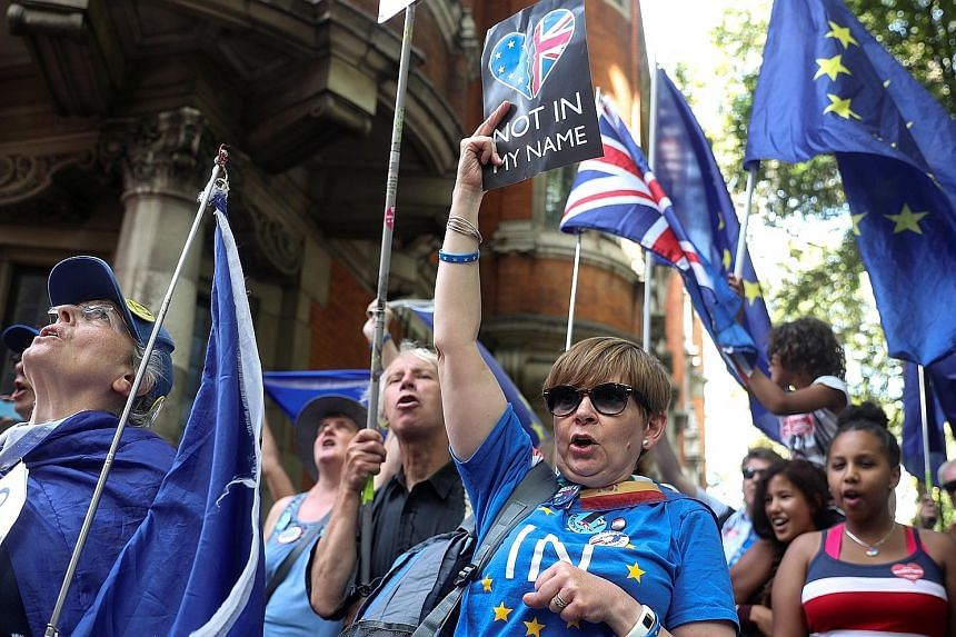 Anti-Brexit protesters outside Westminster in London yesterday. The decision to suspend Parliament has outraged critics and is serving as a unifying force for the disparate opposition, who have confirmed they will press on with measures to block leav