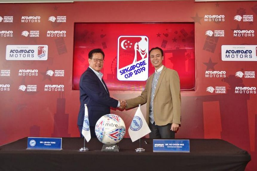 Football Association of Singapore President Lim Kia Tong (left) with Komoco Motors commercial director Ng Choon Wee at the Jalan Besar Stadium on Aug 30, 2019.