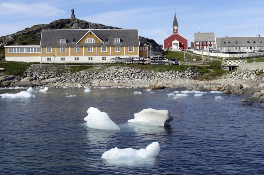 In this image taken on June 13, 2019, small pieces of ice float in the water off the shore in Nuuk, Greenland. At least 30 per cent of the northern hemisphere's surface permafrost could melt by century's end.