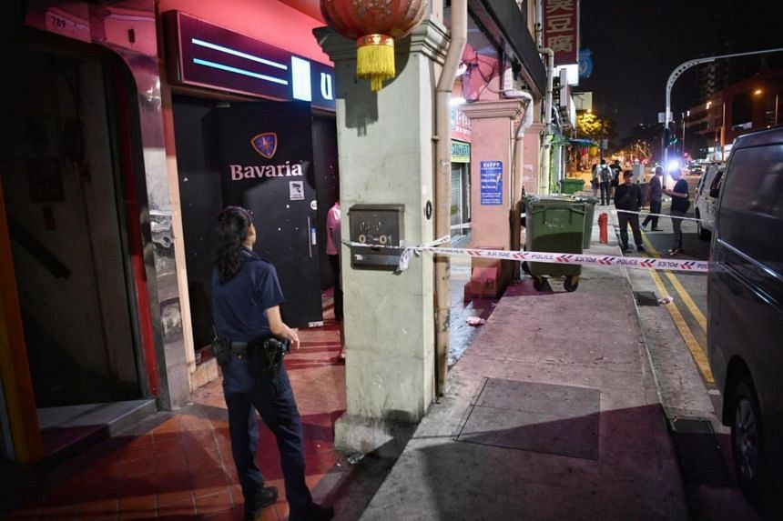 The pavement area in front of U Pub Disco night club cordoned off by the police, with officers conducting investigations on Aug 30, 2019.