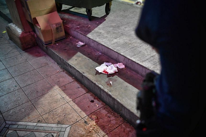 Blood-stained tissue paper littering the pavement outside U Pub Disco night club on Aug 30, 2019.