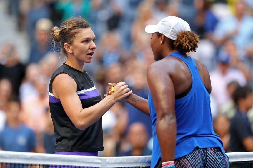 Halep and Taylor Townsend of the US shake hands following their second-round match.