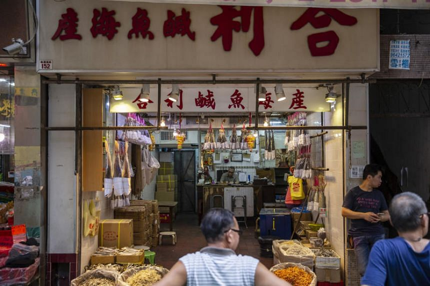 Mr Au Chun Pang's store in the western district of Hong Kong Island. Mr Au said monthly sales at the store have plunged some 20 per cent from the start of the year.