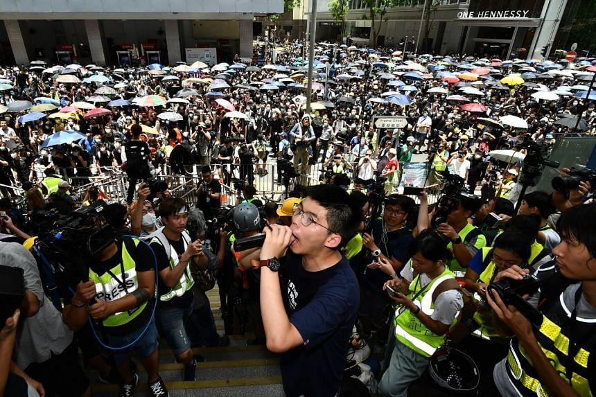 Joshua Wong leading protesters outside the police headquarters on June 21, 2019.