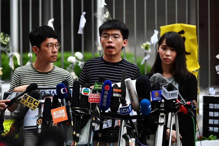 (From left) Demosisto members Nathan Law, Joshua Wong and Agnes Chow responding to Carrie Lam's press conference outside Hong Kong's Legislative Council on June 18, 2019.