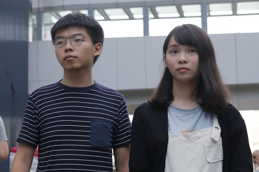 In this photo taken on June 18, 2019, pro-democracy activists Joshua Wong and Agnes Chow meet reporters outside government office in Hong Kong.