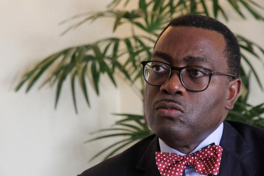African Development Bank president Akinwumi Adesina brushed aside criticism that China's aggressive lending has saddled poorer African countries with mountains of debt.