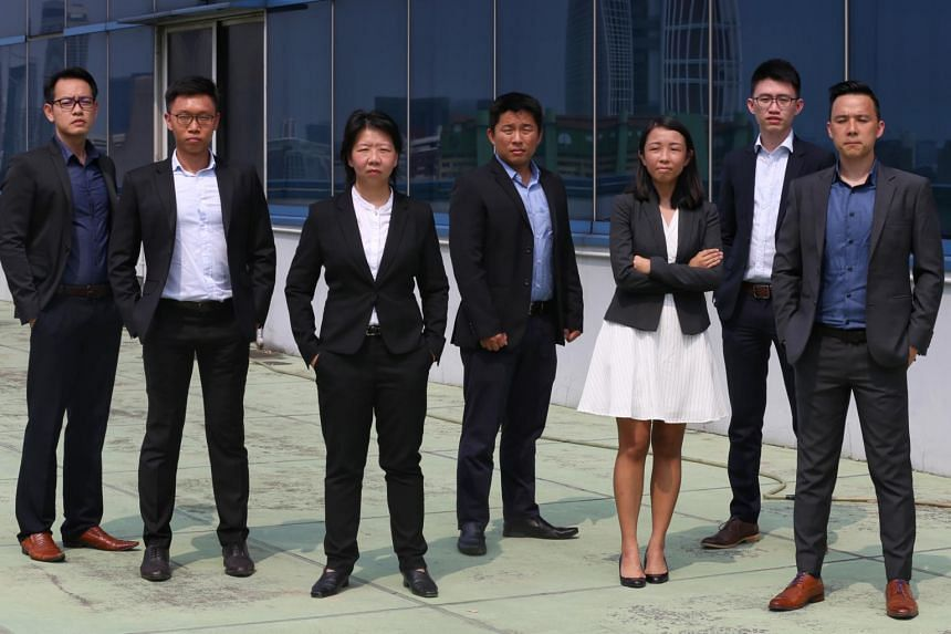 (From left) ASP Koay Lean Seong, DSP Lim Hao Jun, DAC Aileen Yap, ASP Greg Sim Yi Cheng, Ms Sharon Xie, DSP Eric Wong and ASP Lim Min Siang, who conceptualised the Anti-Scam Centre after studying similar set-ups overseas.