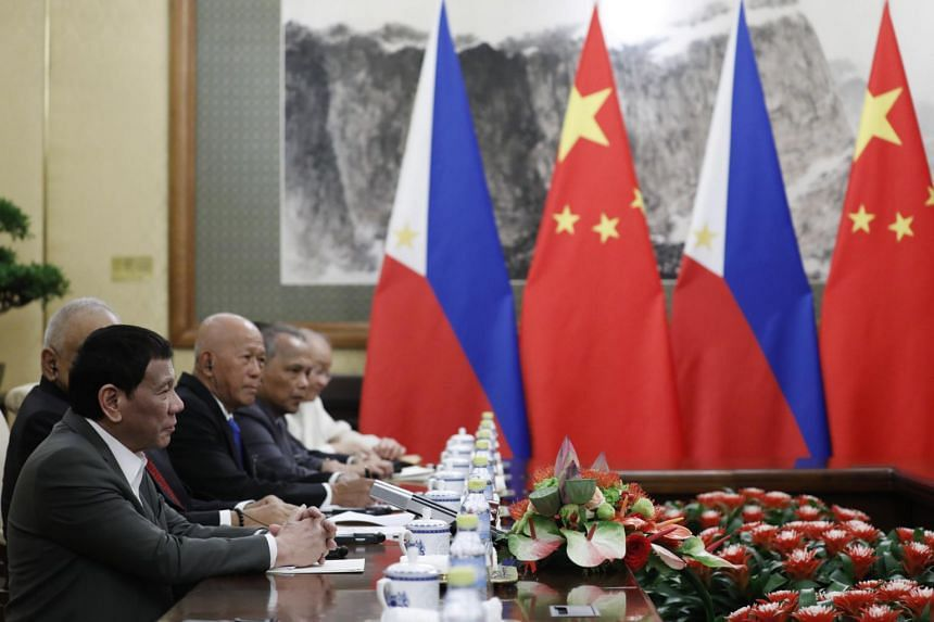 Philippine President Rodrigo Duterte (left) speaks to Chinese President Xi Jinping (not pictured), during their meeting at the Diaoyutai State Guesthouse in Beijing on Aug 29, 2019.