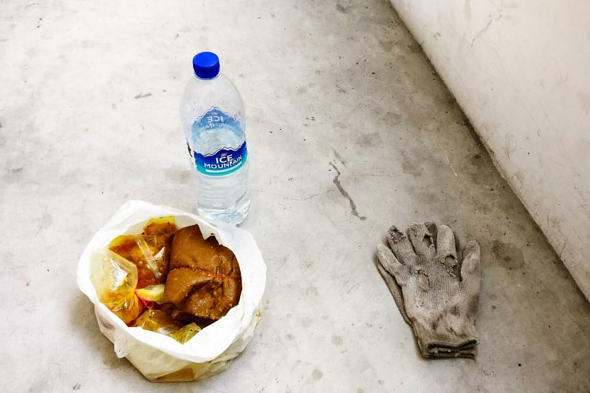 A migrant worker's lunch, photo shortlisted for the Migrant Workers Photography Festival.